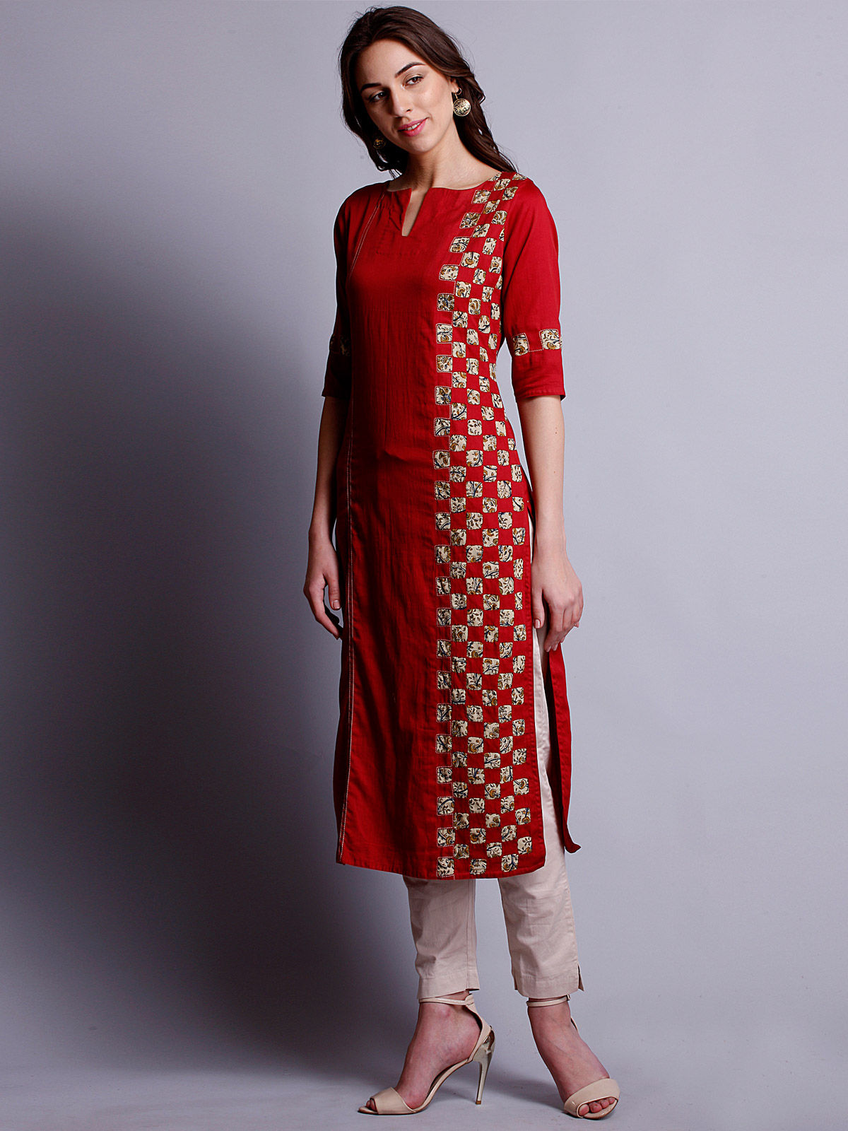 Red color reverse applique cotton satin  kurta with side panel detailing.