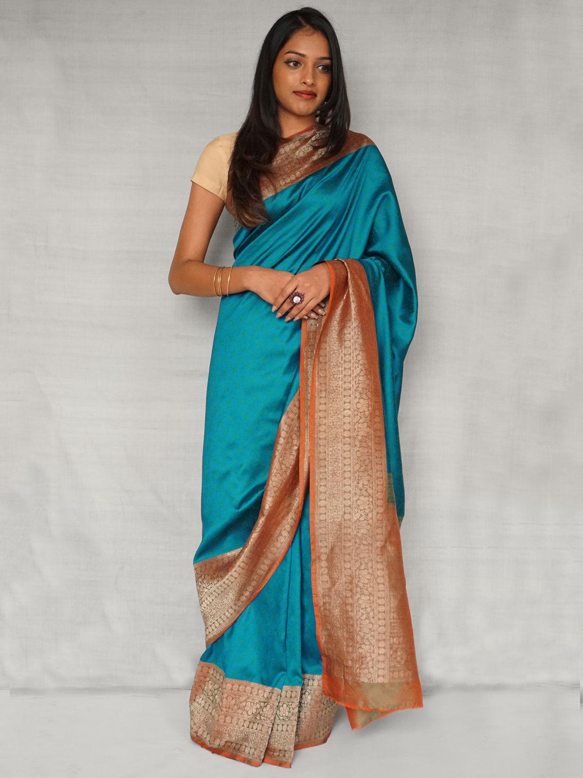 Warm Teal banarasi pure silk saree  with blouse.
