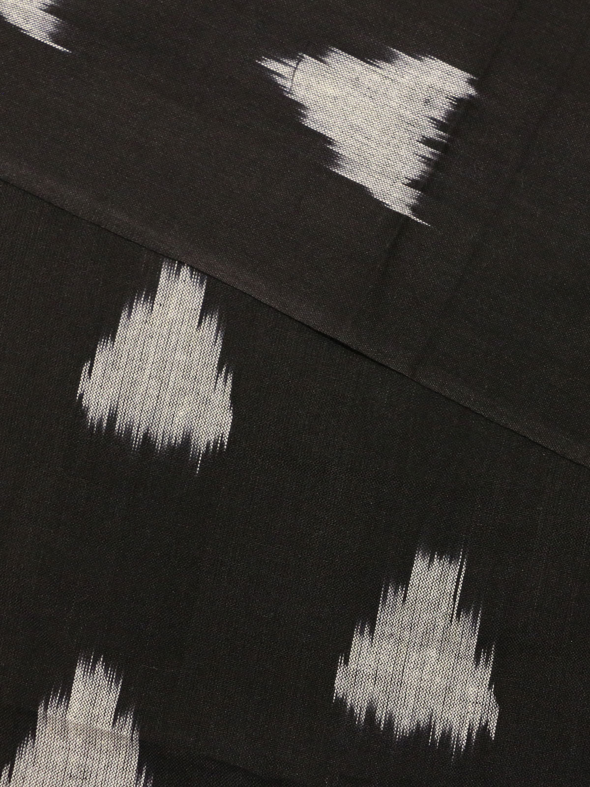 Black color ikat handloom cotton fabric