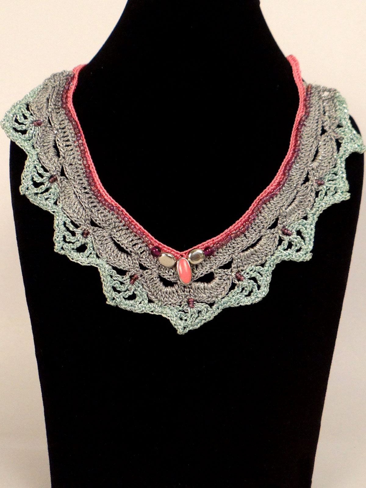 Light green crochet fabric necklace with orange tint
