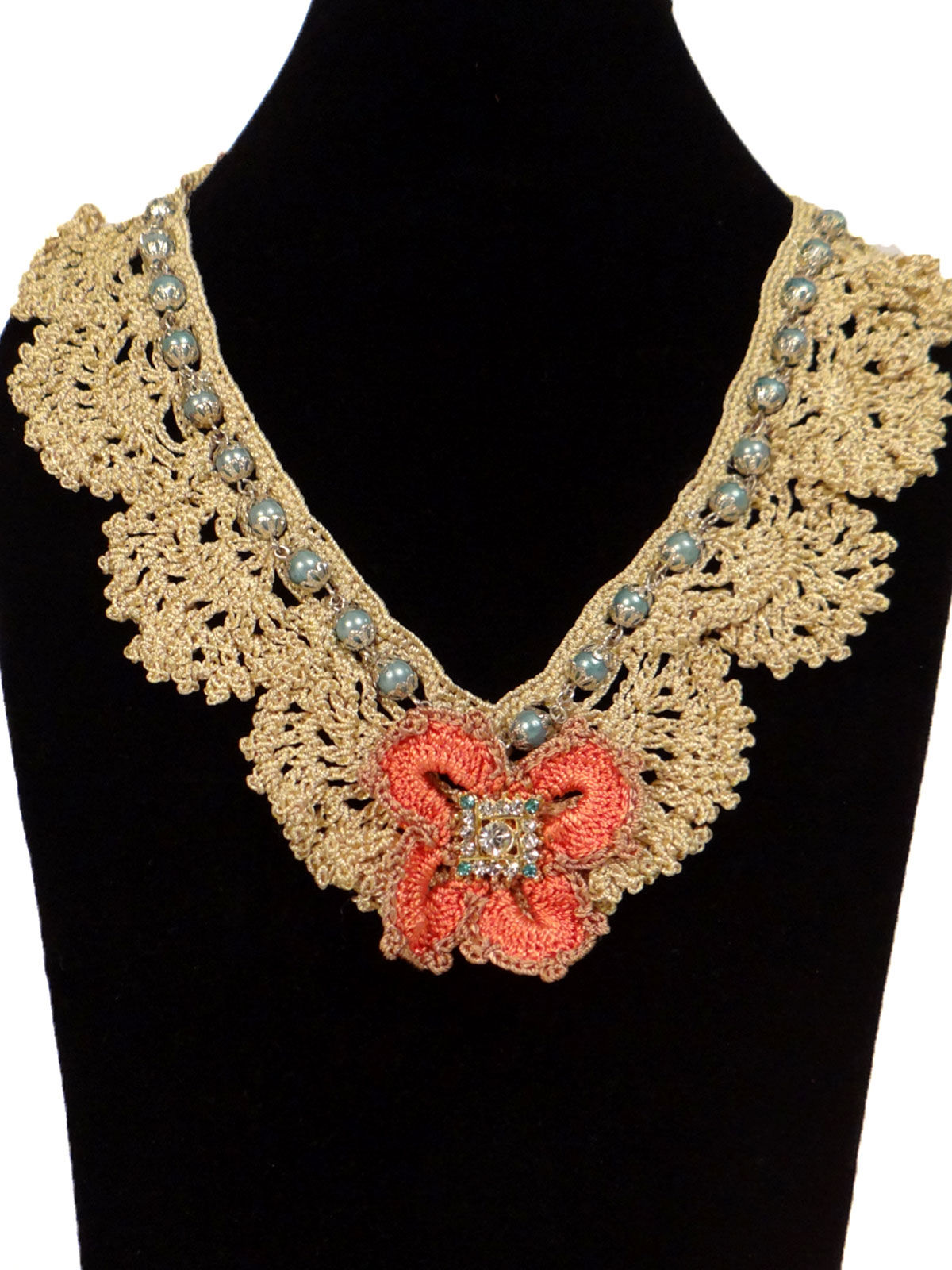 Beige crochet fabric necklace with  pearl beads in the lining