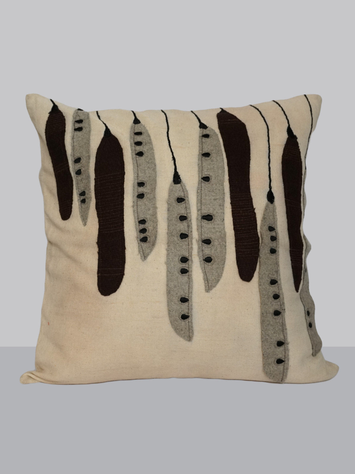 Off-white felt patchwork emroidered cotton cushion cover