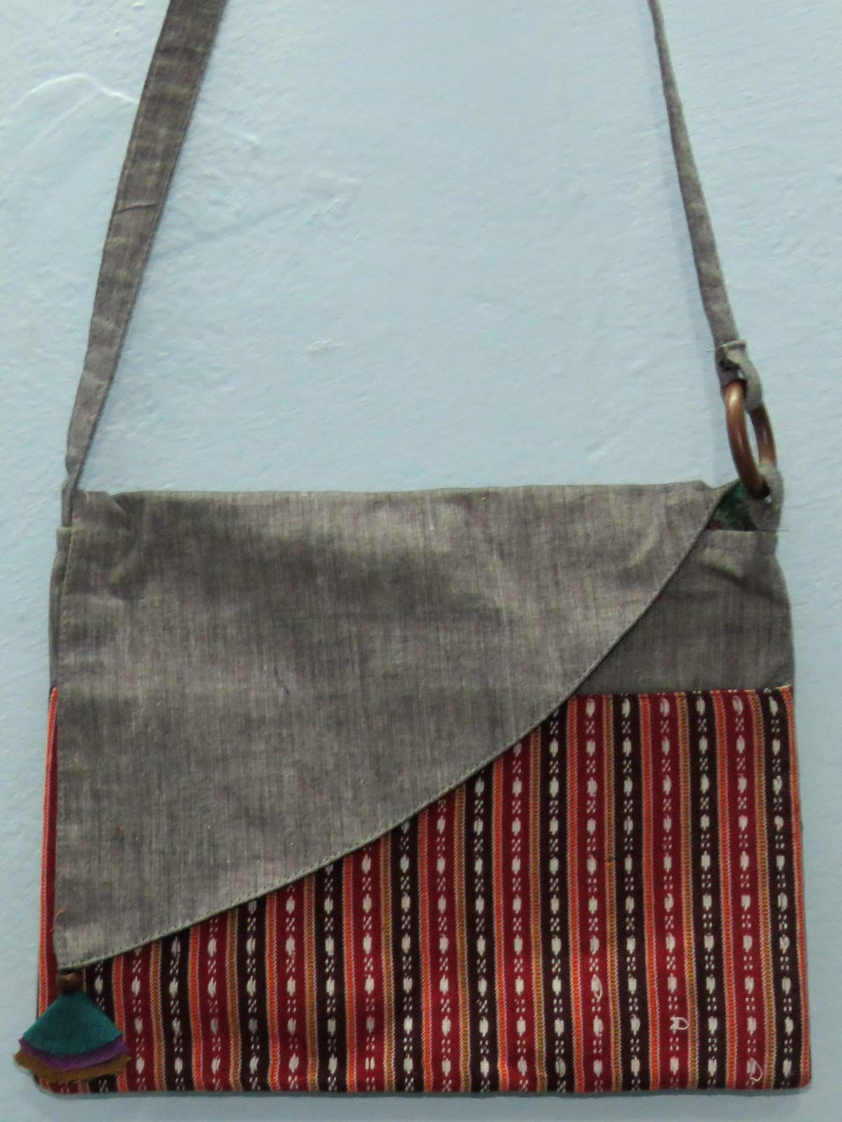 Grey cotton sling bag with patch pocket