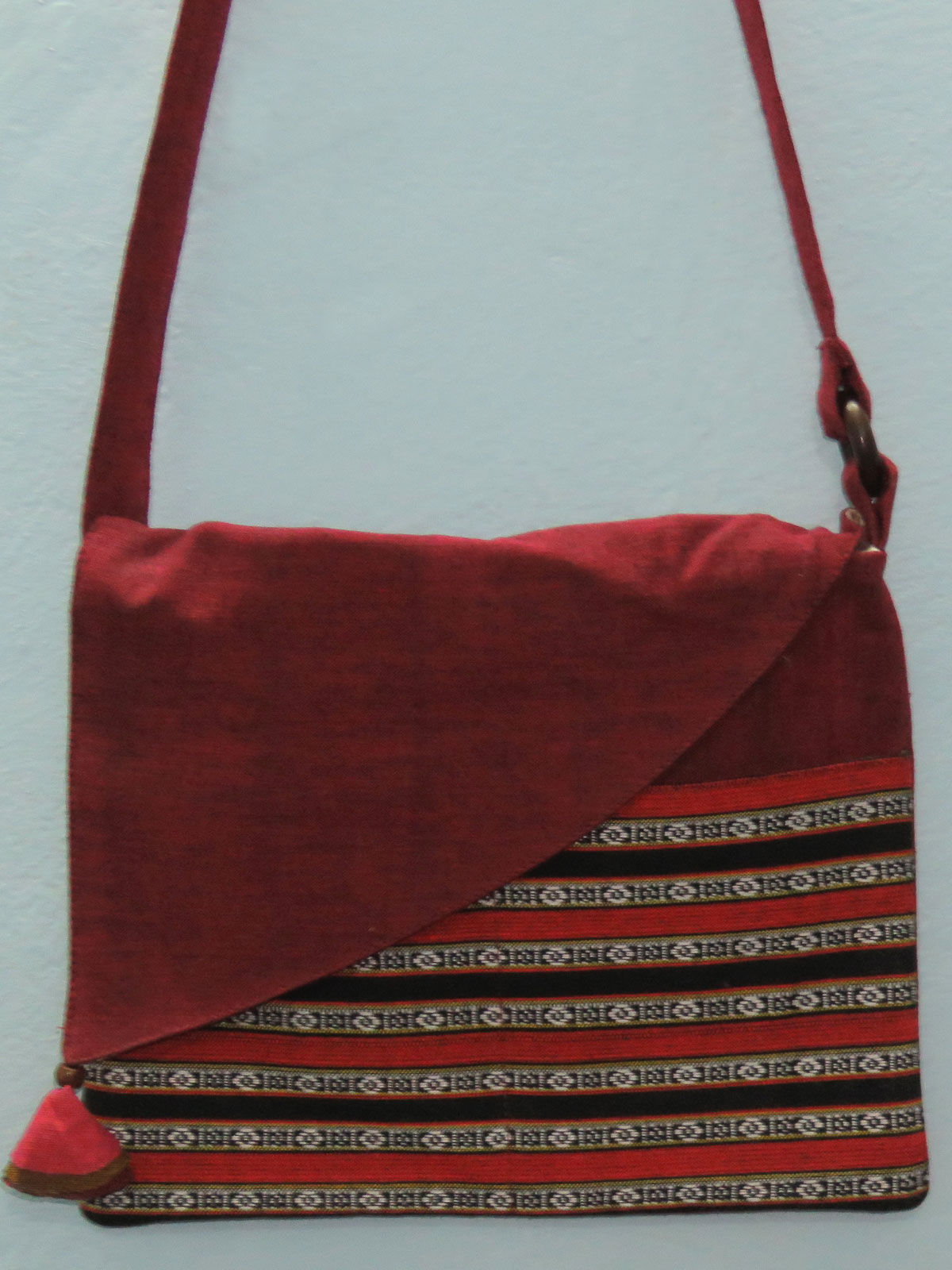 Maroon cotton sling bag with patch pocket