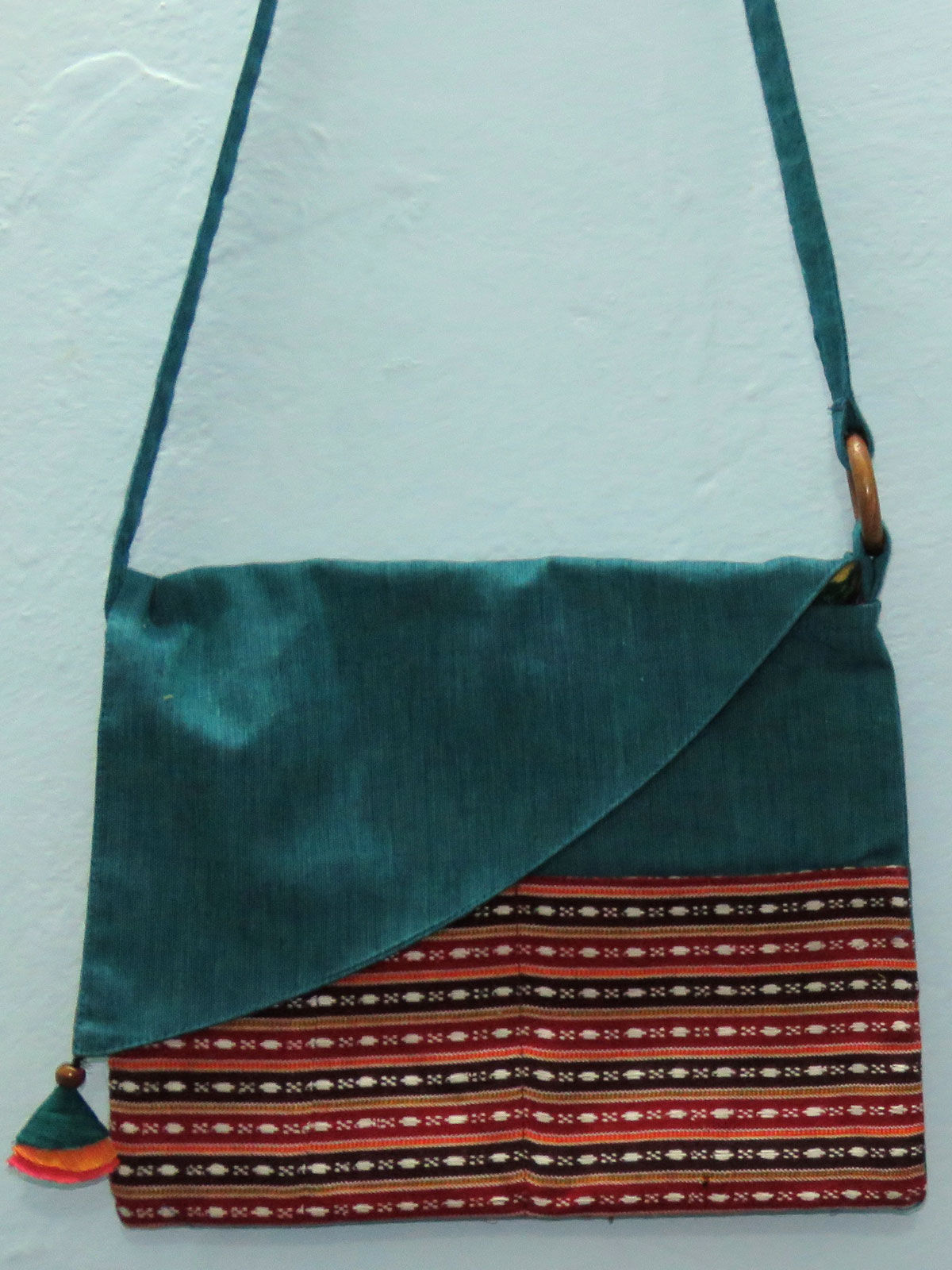 Teal cotton sling bag with patch pocket