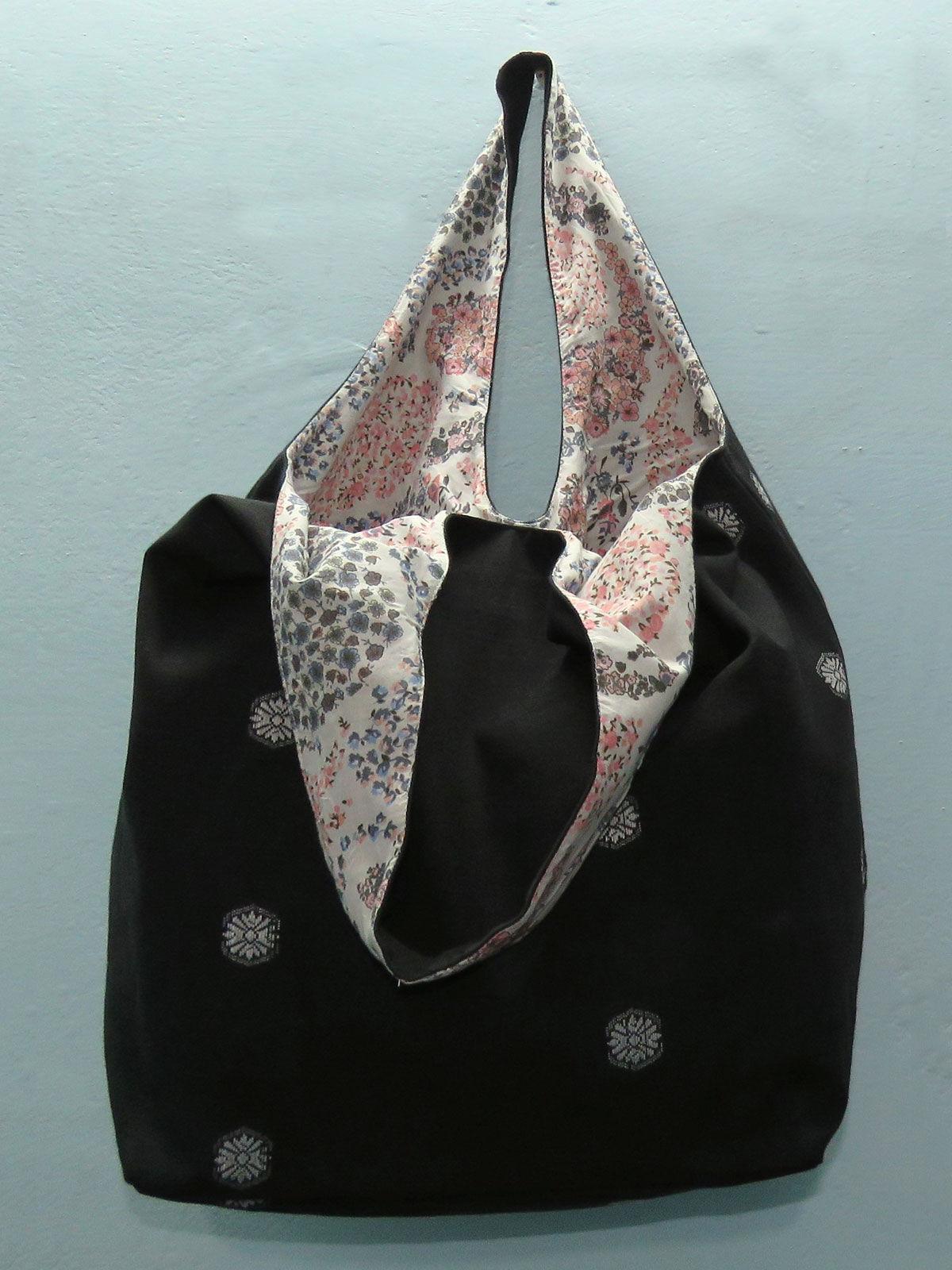 Black handwoven cotton hobo bag