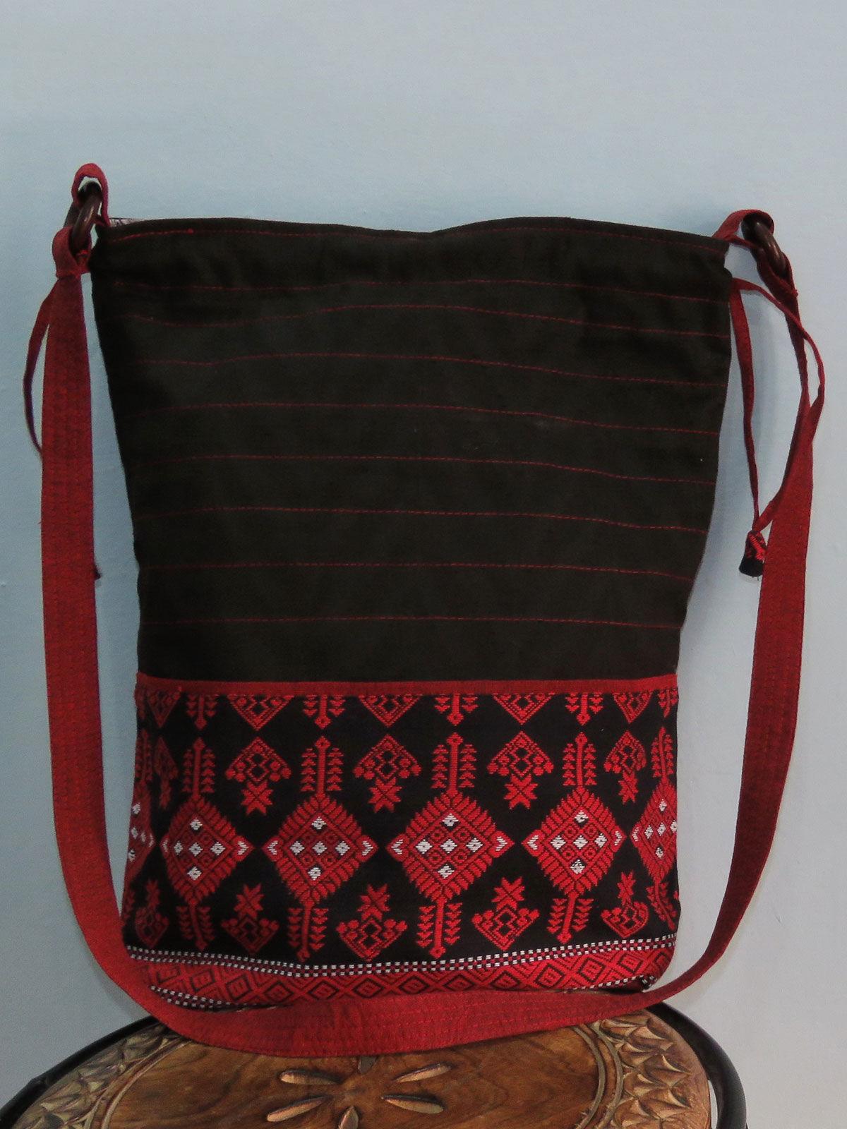 Black Red sling bag in potli stlye.
