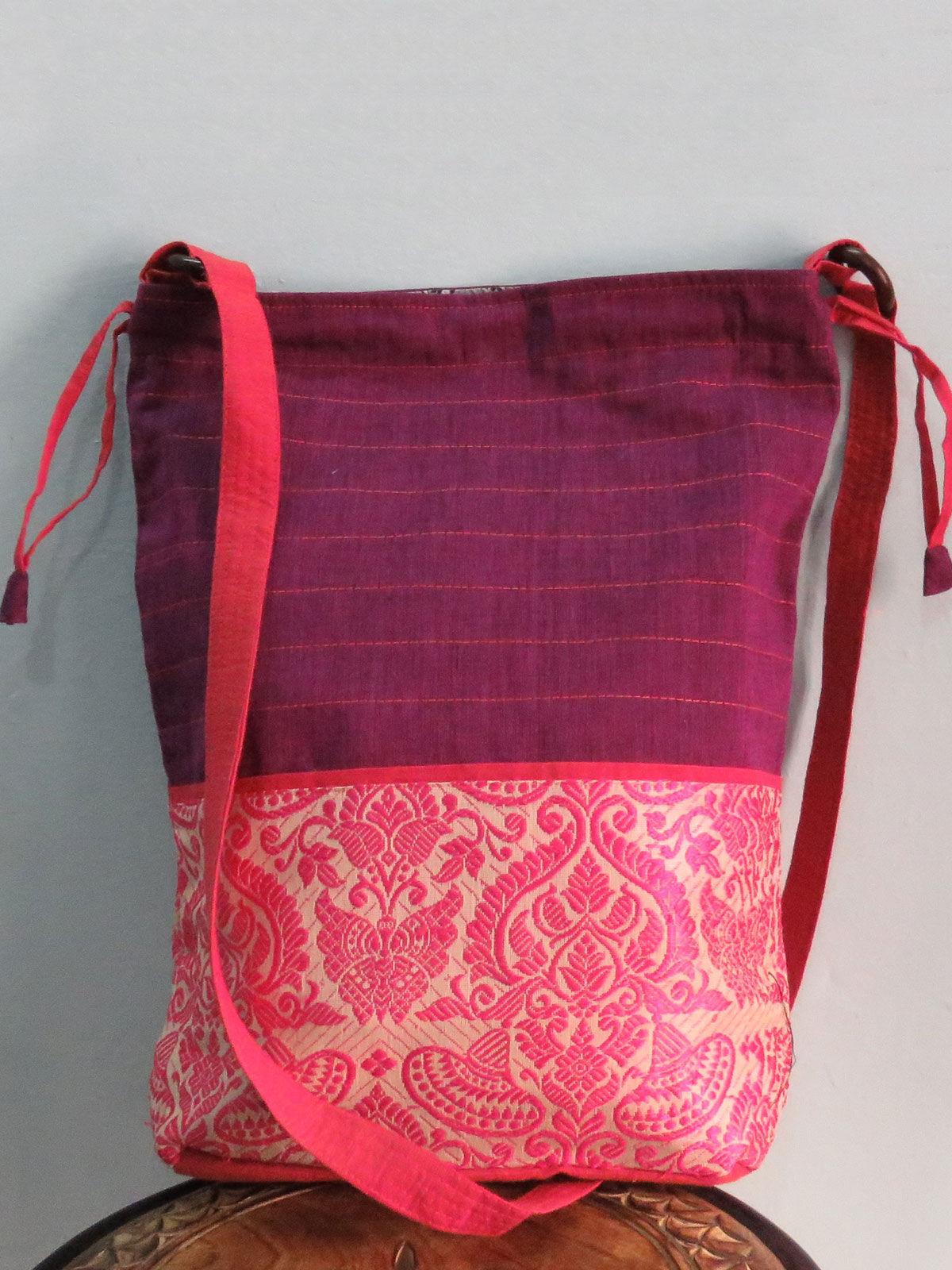 Purple pink sling bag in potli stlye.