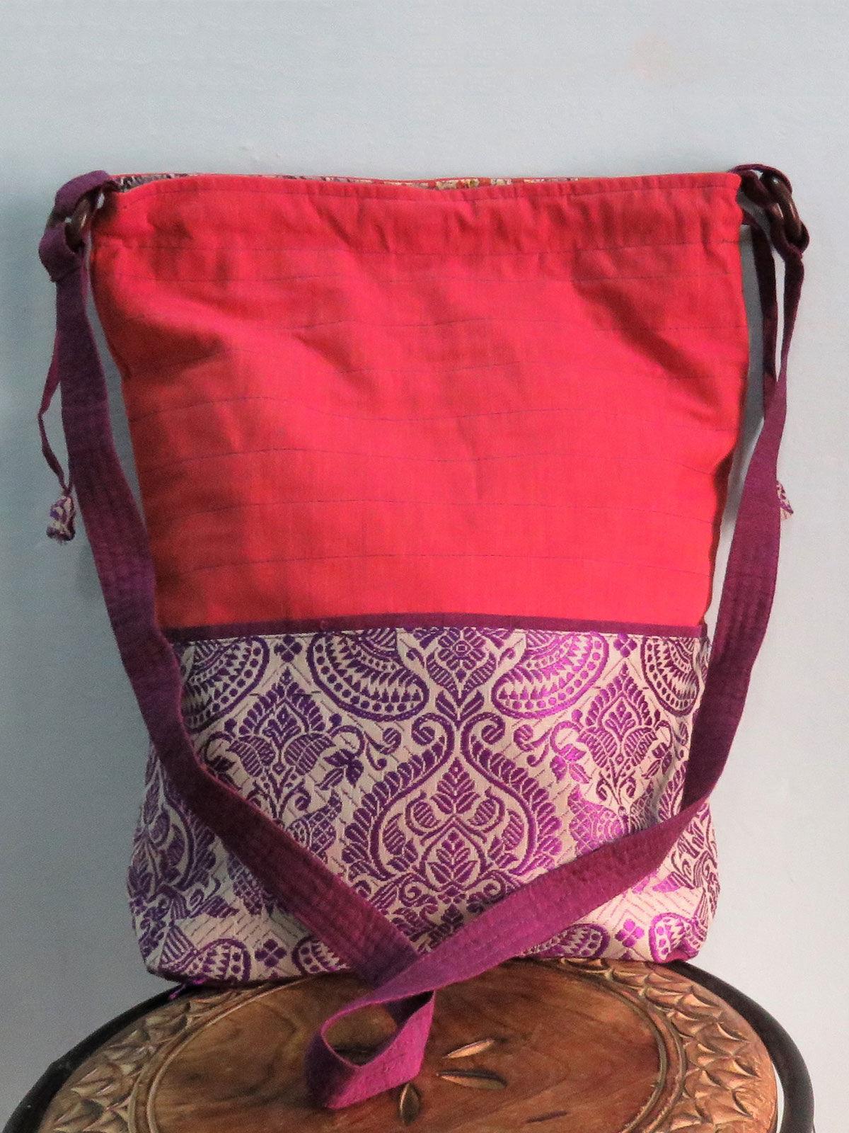 Pink sling bag in potli stlye.