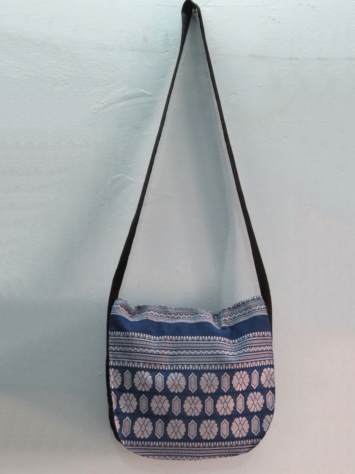 Indigo messenger bag with handwoven design.