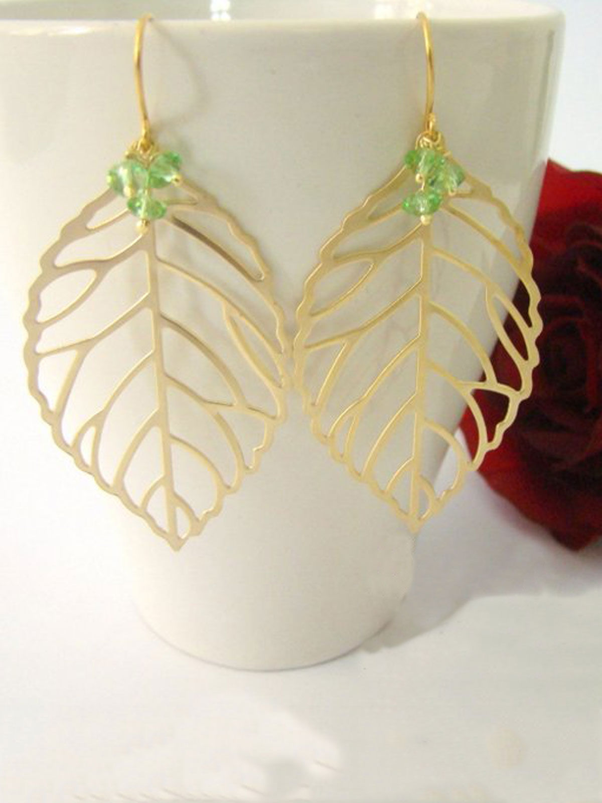 Golden leaves with green beads