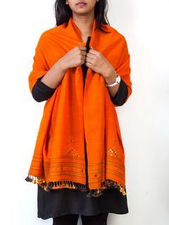 Orange totemic embroidered shawl.