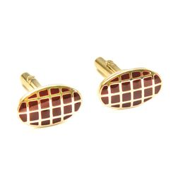 ELLIPTICAL GOLDEN CUFFLINK WITH CORAL RED SQUARES INLAY