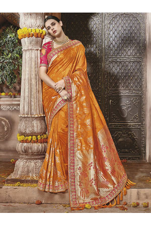 Orange Kanjeevaram silk saree with embroidery