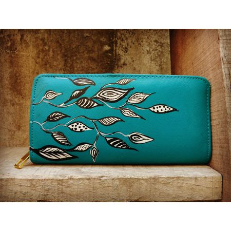 white leaf on blue wallet