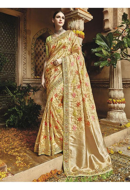 Cream Kanjeevaram silk saree with embroidery