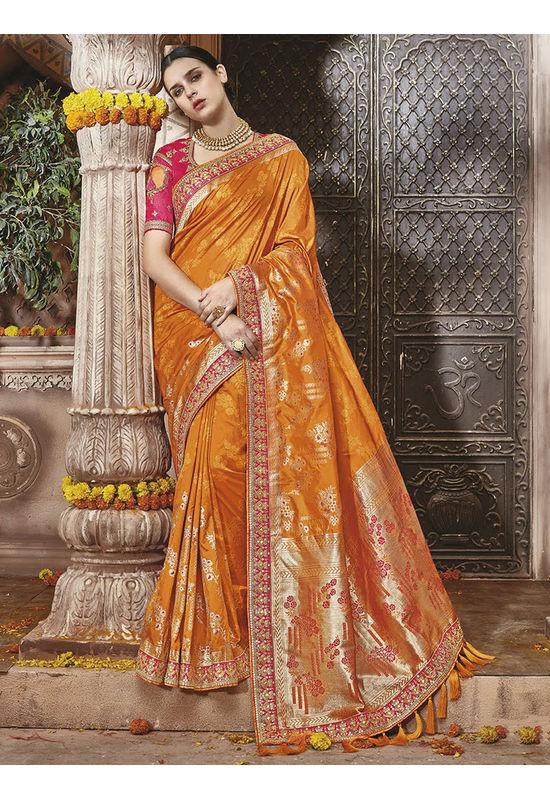 Orange Kanjeevaram silk saree with embroidery