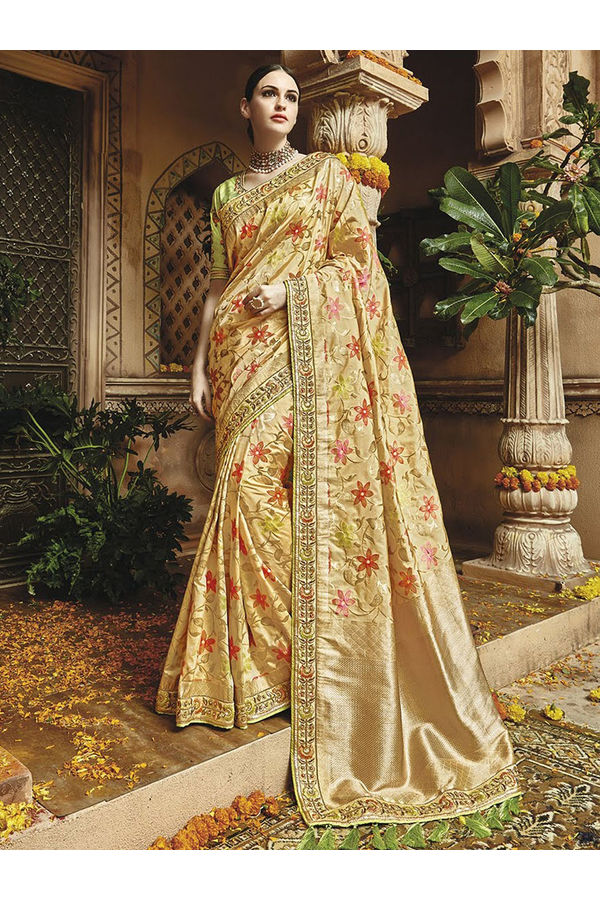Cream Kanjeevaram silk saree with embroidery