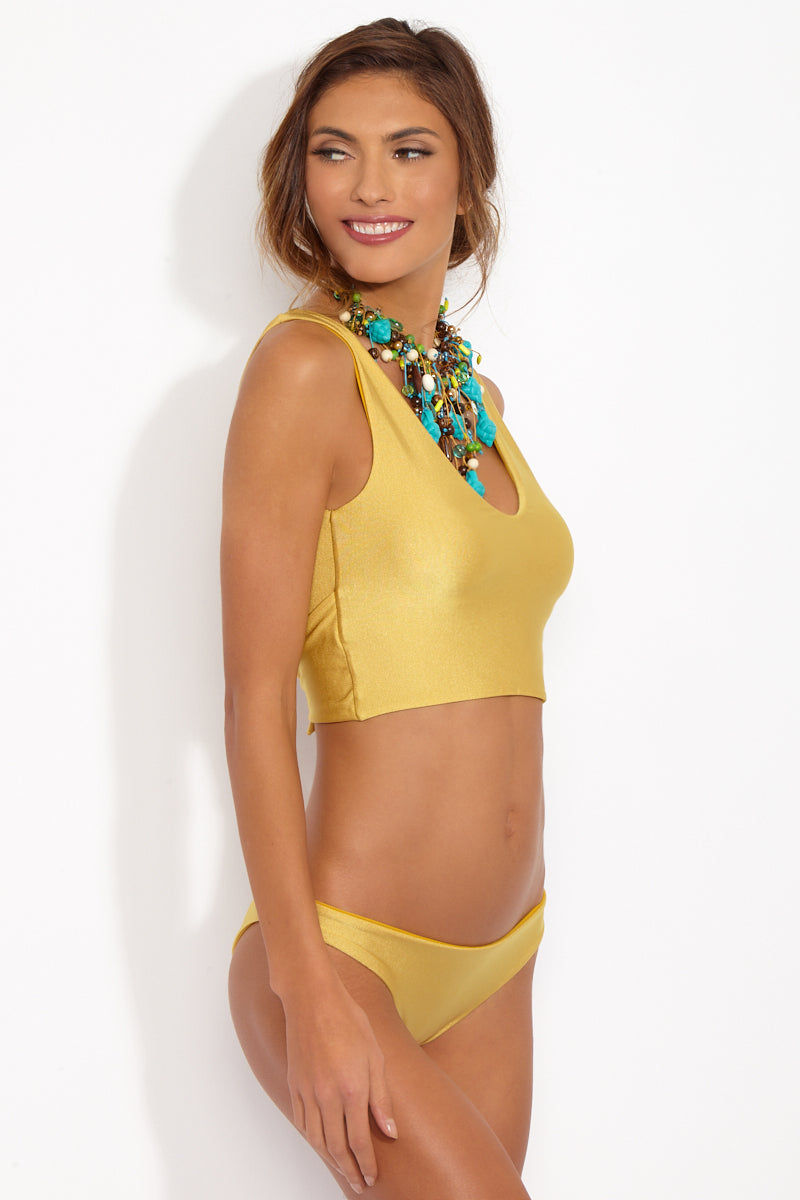 CAMI AND JAX Gold Coast Meilani Mid Rise Bottom Bikini Bottom | Gold Coast| Cami and Jax Meilani Mid Rise Bottom Side View Metallic gold mid rise bikini bottom with moderate coverage.