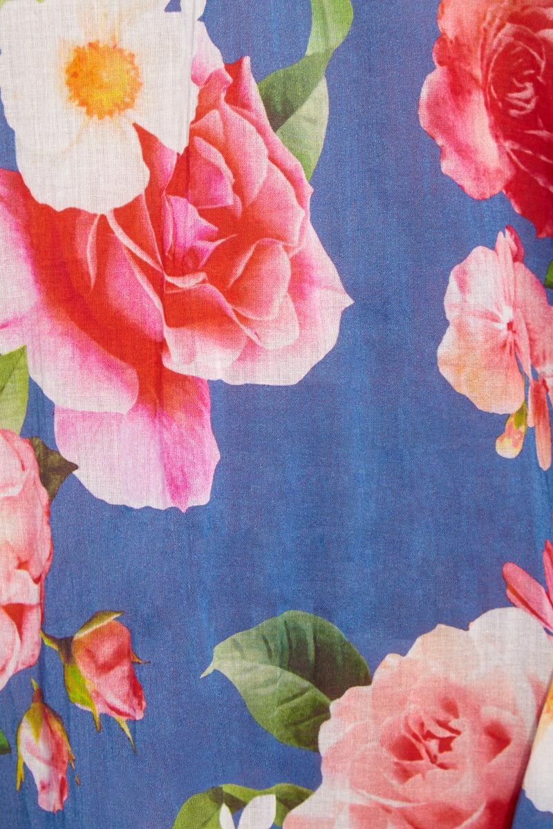 RINIKINI Chloe Kaftan Cover Up | Indigo Blue Floral| Rinikini Chloe Kaftan close up detail Deep blue floral print adjustable tie back off the shoulder long-sleeved A-line kaftan with crochet pom-pom neckline and tassel trim details.