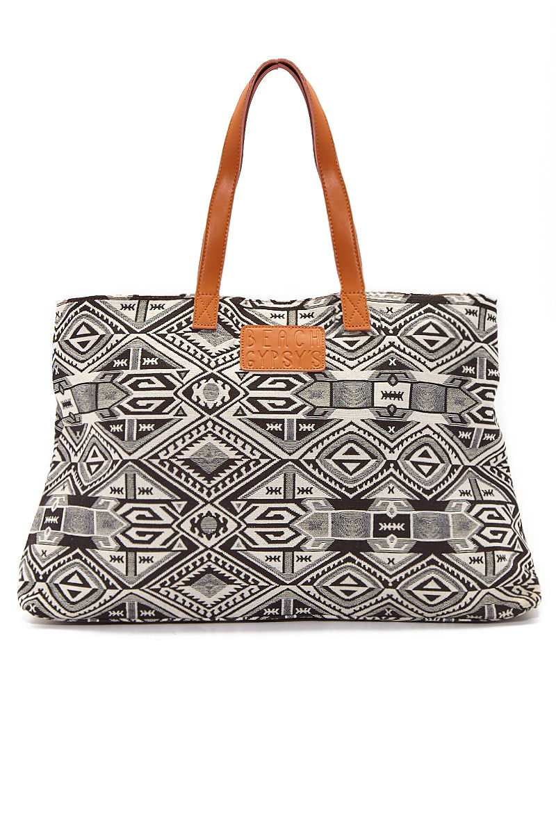 BEACH GYPSY'S Oversized Jacquard Beach Tote - Black & White Geometric Print Bag | Black & White Geometric Print|  Beach Gypsy's Tribal Tote - Black & White Geometric Print Oversized jacquard leather strap zipper closure beach tote bag with interior pockets. Eye-catching classic black and ivory geometric abstract print provides a bohemian style statement with any beach or pool outfit. Front View