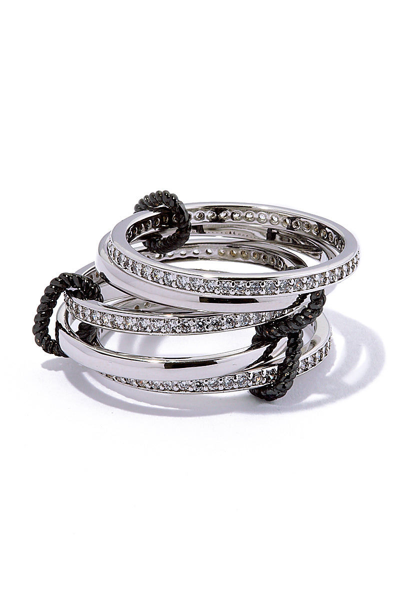 AURORAH Circle Of Love Rings - Silver Nails | Silver| Aurorah Circle Of Love Rings - Silver Stacked View 5 silver colored bands. 3 set with cz's. All connected by edgy gunmetal oval connectors. One size fits most middle and/or ring fingers. Rhodium plated brass safe for sensitive skin.