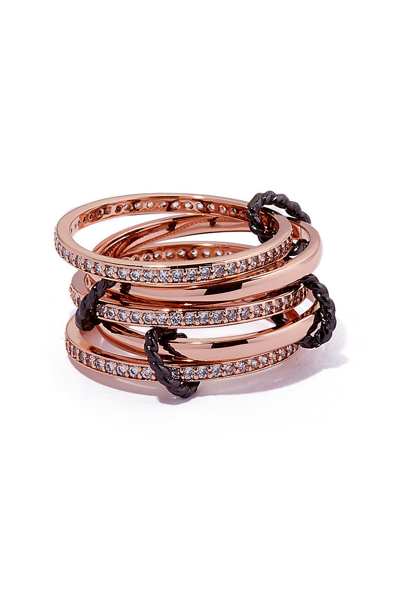 AURORAH Circle Of Love Rings - Rose Jewelry | Rose| Aurorah Circle Of Love Rings - Rose Stacked View 5 rose gold colored bands 3 set with cz's All connected by edgy gunmetal oval connectors One size fits most middle and/or ring fingers Rose Gold plated brass
