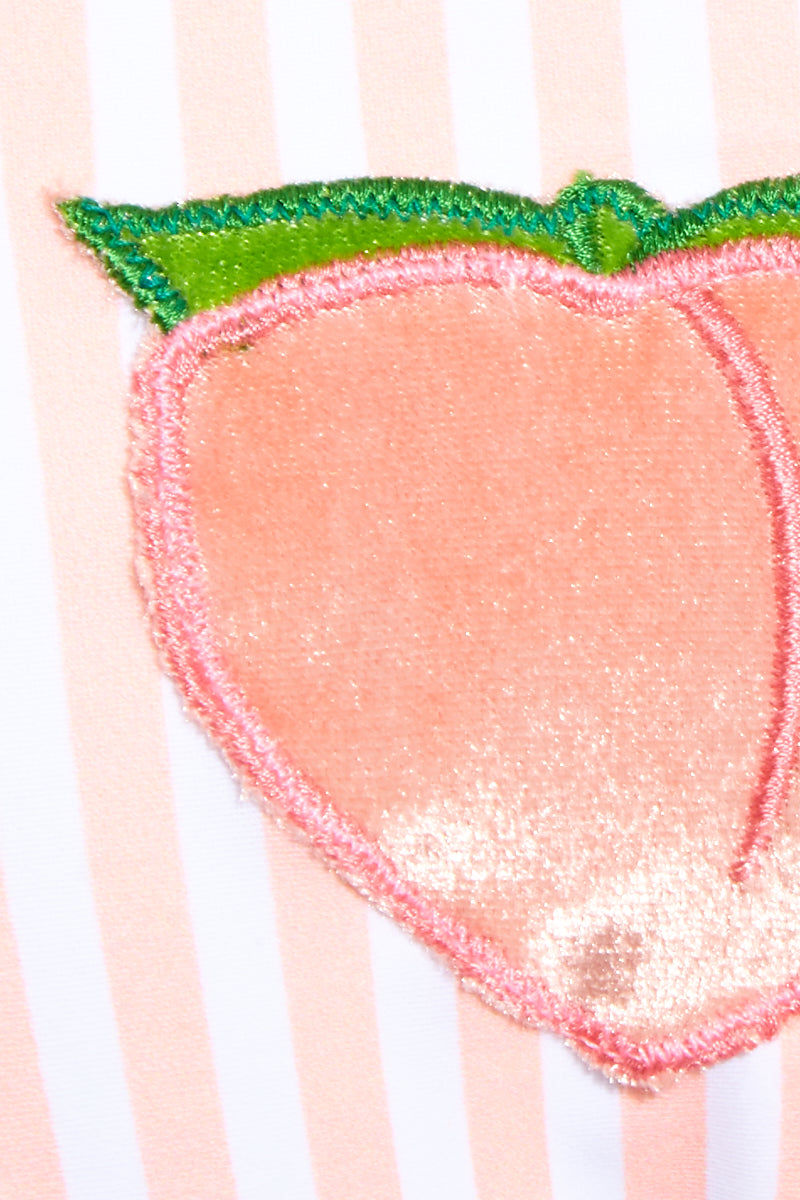 LOLLI Peach Lover Bralette Bikini Top - Peaches N Cream Stripes Bikini Top | Peaches N Cream Stripes| Lolli Peach Lover Bralette Top - Peaches N Cream Stripes Bralette style bikini top in peach and white vertical stripes and fuzzy peach patches at each side of the bust. Ties at center back.