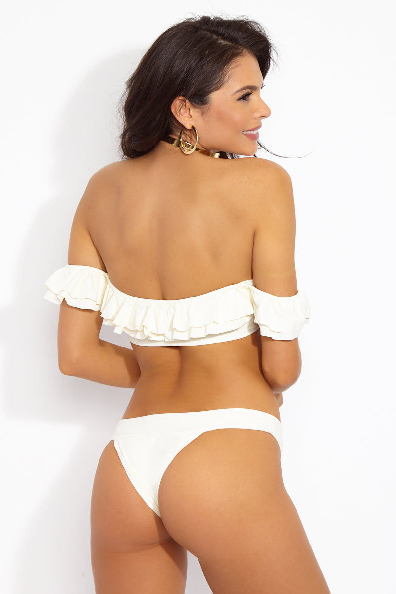 MGS Banned Skimpy Bikini Bottom - Ivory White Bikini Bottom | Ivory White| M.G.S Banned Skimpy Bikini Bottom - Ivory White Low-rise skimpy bikini bottom in luxe ivory fabric. Cheeky rear coverage flatters and shows off your booty. Thick band detail Back View