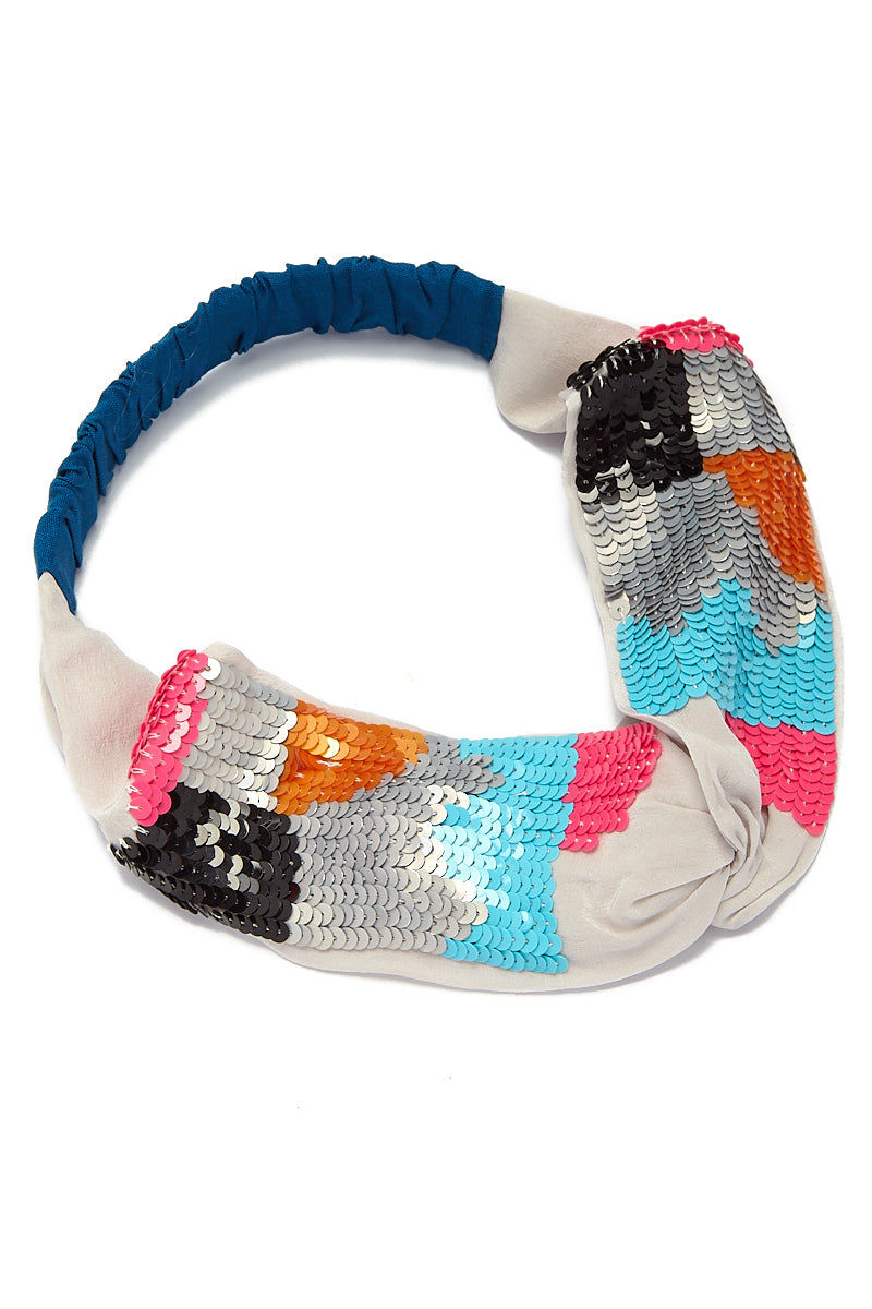 NAMJOSH Multi Wave Sequin Turban - Rainbow Block Print Hair Accessories |  Rainbow Block Print| Namrata Joshipura Multi Wave Sequin Turban - Multi Wave Sequin Turban - Rainbow Block Print  The soft, chiffon-like fabric is breathable and lightweight and will have you dreaming of exotic lands. The beautiful color-blocked pattern in black, grey, blue, pink, and orange sequins add a statement to any outfit. Front View
