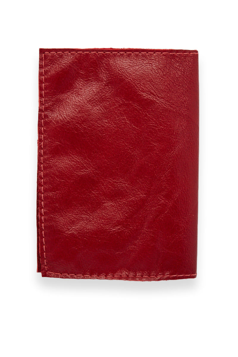 BLYTHE LEONARD Passport Cover - Red/Silver Accessories | Red/Silver| Blythe Leonard Passport Cover -Red/Silver Interior pocket for passport Additional adjacent pocket One Interior card slot patch pocket  Metallic silver embossed lettering  Red smooth leather  Handmade in the US Back View