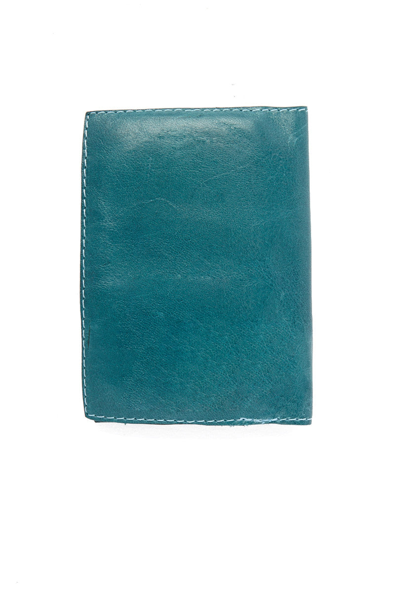 BLYTHE LEONARD Passport Cover - Bermuda Blue Accessories | Bermuda Blue| Blythe Leonard Passport Cover - Bermuda Blue Interior pocket for passport Additional adjacent pocket One Interior card slot patch pocket  Silver embossed lettering  Handmade in the USA Teal color  Genuine leather finish with subtle wrinkling  Pattern may very from picture shown Back View