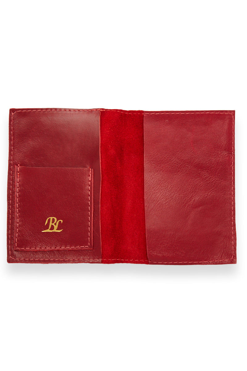 BLYTHE LEONARD Passport Cover - Red/Gold Accessories   Red/Gold  Blythe Leonard Passport Cover - Red/Gold Interior pocket for passport Additional adjacent pocket One Interior card slot patch pocket  Gold embossed lettering  Red smooth leather  Handmade in the US Front View