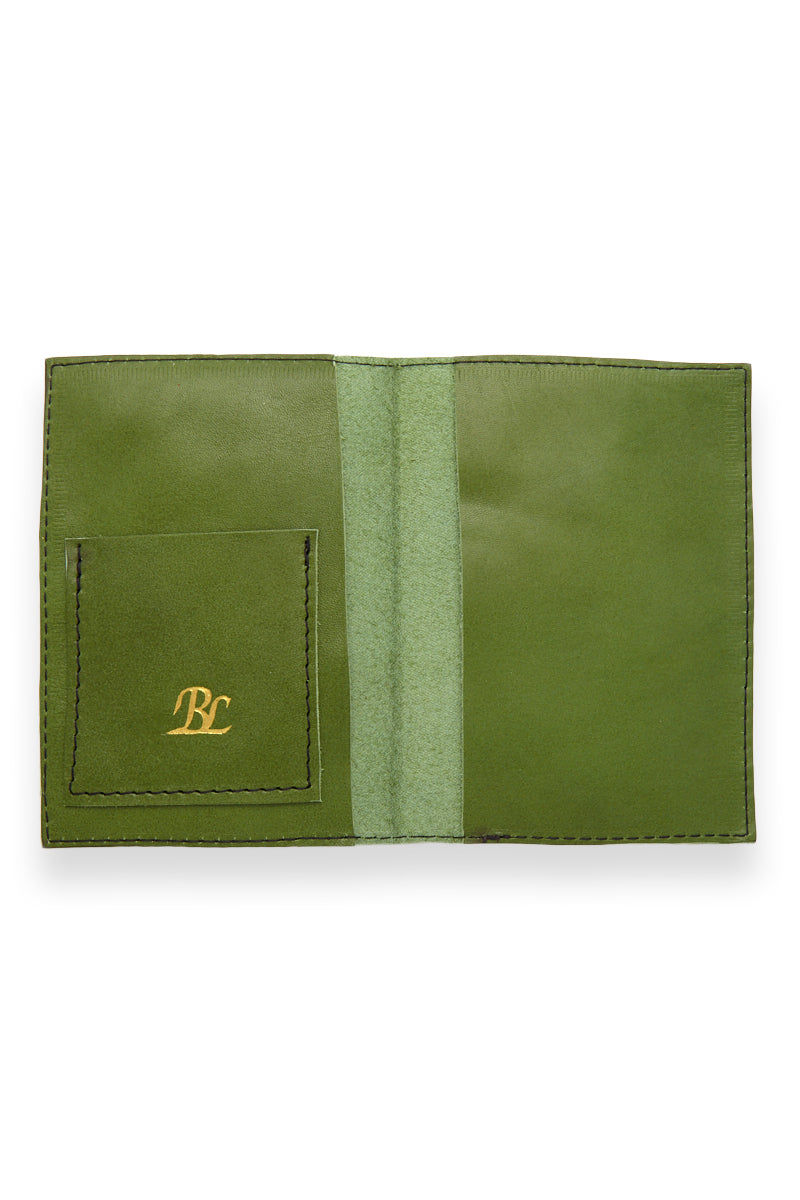 BLYTHE LEONARD Passport Cover - Apple Green/Gold Accessories | Apple Green/Gold| Blythe Leonard Passport Cover - Apple Green/Gold Interior pocket for passport Additional adjacent pocket One Interior card slot patch pocket  Green leather  Gold embossed lettering  Handmade in the US Pattern may vary from picture shown Front View