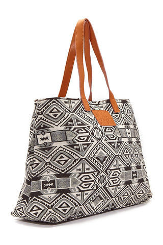 BEACH GYPSY'S Oversized Jacquard Beach Tote - Black & White Geometric Print Bag | Black & White Geometric Print|  Beach Gypsy's Tribal Tote - Black & White Geometric Print Oversized jacquard leather strap zipper closure beach tote bag with interior pockets. Eye-catching classic black and ivory geometric abstract print provides a bohemian style statement with any beach or pool outfit. Side View