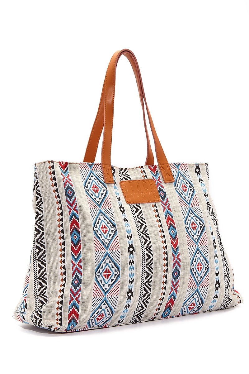 BEACH GYPSY'S Oversized Jacquard Beach Tote - Serape Aztec Print Bag   Serape Aztec Print  Beach Gypsy's Tribal Tote - Serape Aztec Print Oversized jacquard leather strap zipper closure beach tote bag with interior pockets. Eye-catching multicolor geometric abstract print provides a bohemian style statement with any beach or pool outfit. Front View