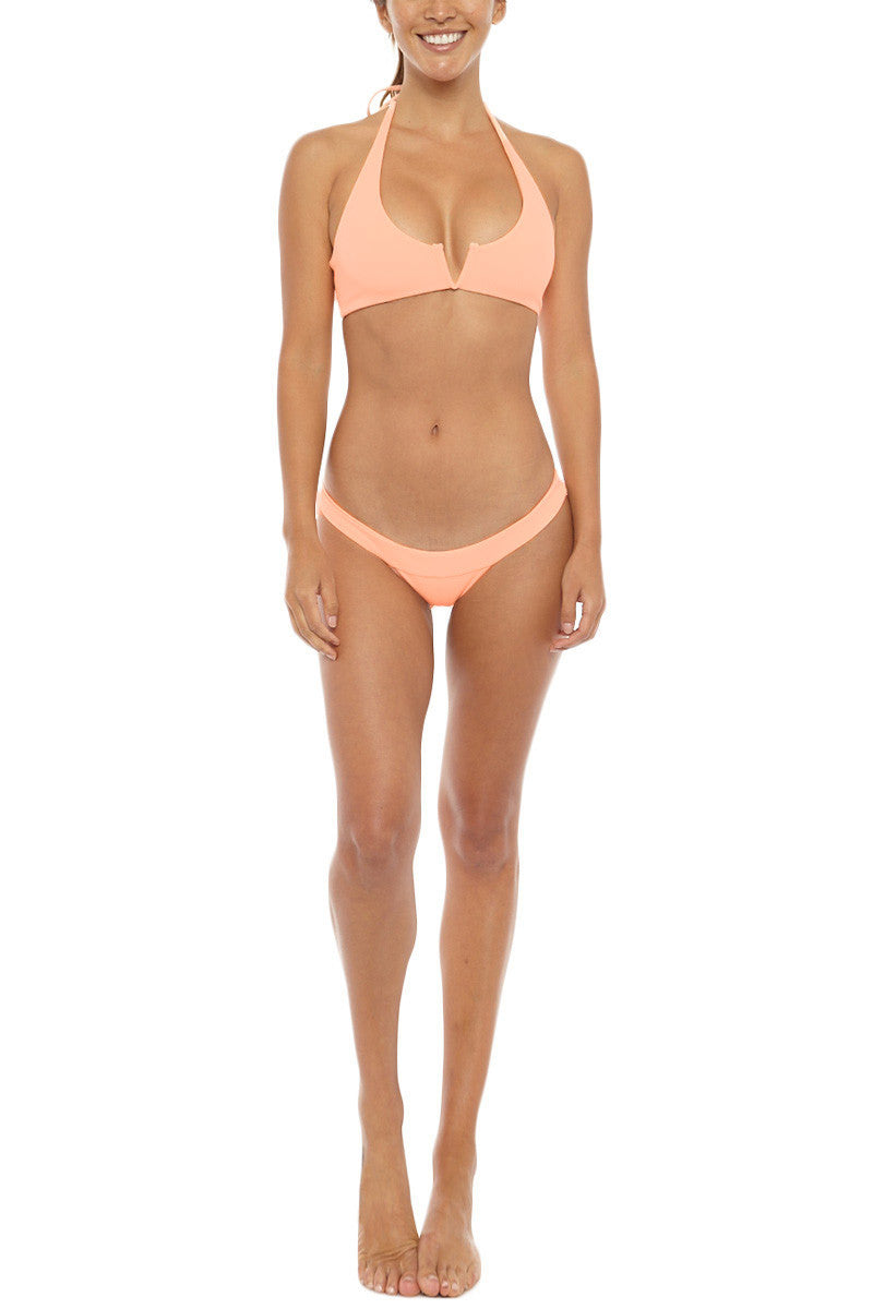 MGS Banned Ribbed Skimpy Bikini Bottom - Apricot Orange Bikini Bottom | Apricot Orange| M.G.S Banned Ribbed Skimpy Bikini Bottom - Apricot Orange Low rise Cheeky coverage Ribbed fabric  Light Peach color  80% Nylon, 20% Spandex  Front View
