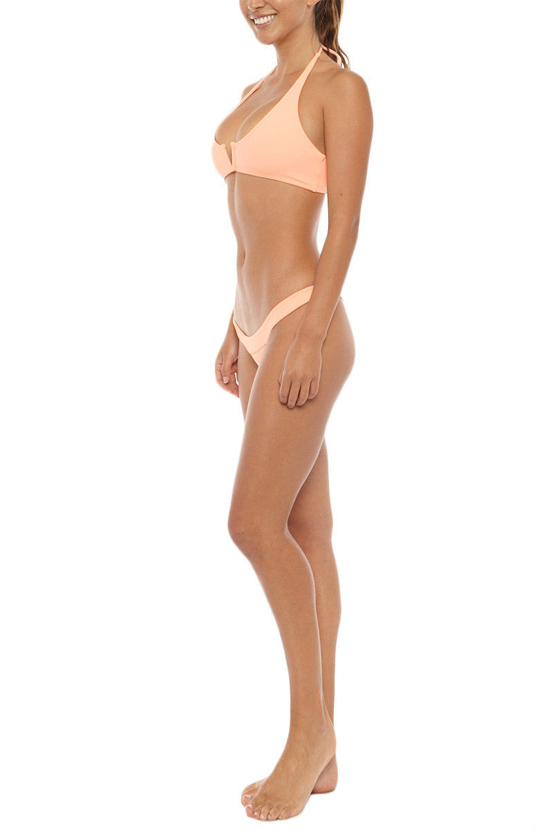 MGS Banned Ribbed Skimpy Bikini Bottom - Apricot Orange Bikini Bottom | Apricot Orange| M.G.S Banned Ribbed Skimpy Bikini Bottom - Apricot Orange Low rise Cheeky coverage Ribbed fabric  Light Peach color  80% Nylon, 20% Spandex  Side View