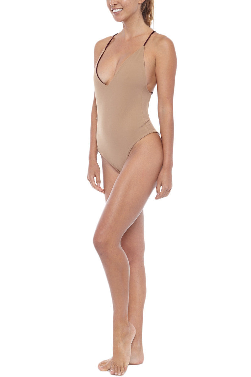 DBRIE Willi Velvet Reversible Criss Cross Back One Piece Swimsuit - Amaretto Brown/Light Latte Brown One Piece | Amaretto Brown/Light Latte Brown| DBrie Willi Velvet Reversible Criss Cross Back One Piece Swimsuit - Amaretto Brown/Light Latte Brown Plume colored velvet one piece swimsuit reversible to sleek, dark nude Lycra. Deep scoop neck shows off the perfect amount of cleavage. Adjustable spaghetti straps criss-cross over the open back. Cheeky bottom coverage Front View