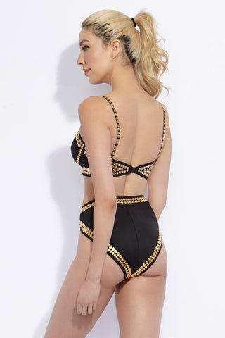NORMA KAMALI Studded High Waist Bikini Bottom - Black N Gold Bikini Bottom | Black N Gold| Norma Kamali Studded High Waist Bikini Bottom - Black N Gold. Back View. High-cut legs elongate your frame while providing moderate rear coverage. Stud trim give the bikini bottom a strong, armored look reminiscent of a warrior princess.