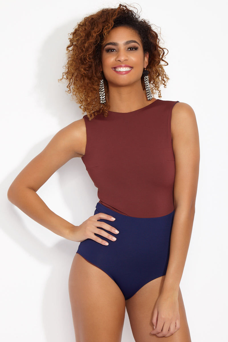 MYMARINI Outfit Reversible High Neck Sleeveless One Piece Swimsuit - Navy Blue/Rosewood Red One Piece | Navy Blue/Rosewood Red| MYMARINI Outfit Reversible High Neck Sleeveless One Piece Swimsuit - Navy Blue/Rosewood Red - Brick red and navy color block reversible one-piece swimsuit. Made of high-quality sustainable fabric from Italy, designed in Germany, and sourced and made in Europe using fair labor. Front View