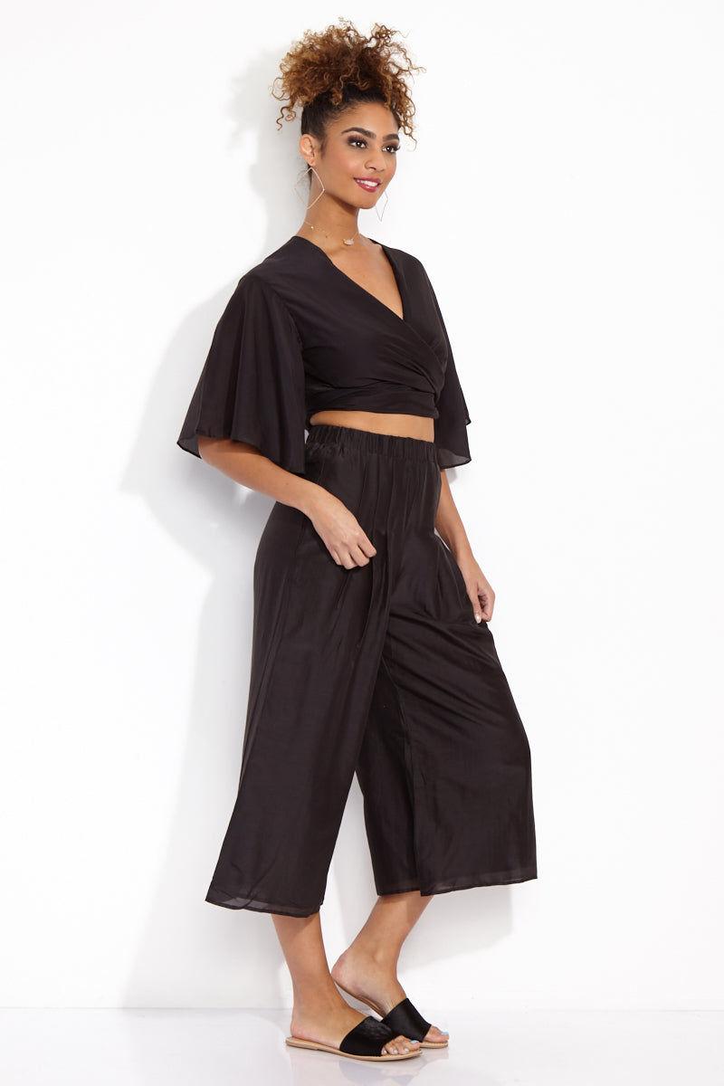 SOAH Coco Crop Pants - Black Pants | Black|SOAH  Coco Crop Pants Side View in Black. Culotte style.   Flowy cotton/silk fabric with elastic waist.