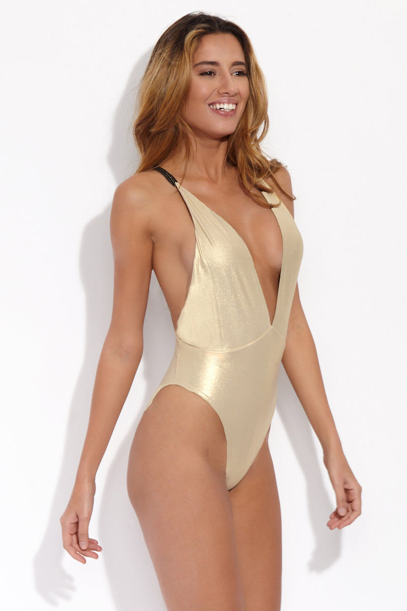 LULI FAMA Reversible Deep V One Piece Swimsuit - Black Shimmer One Piece   Black Shimmer  Luli Fama Reversible Deep V One Piece Swimsuit - Black Shimmer. Features: Reversible deep-v halter one piece body suit. Flaunt your dark side in ribbed black whipcord fabric with a gold foil pinstripe that gives a bronze effect. Reverse to a bold a shimmery gold rush color to dazzle and shine.