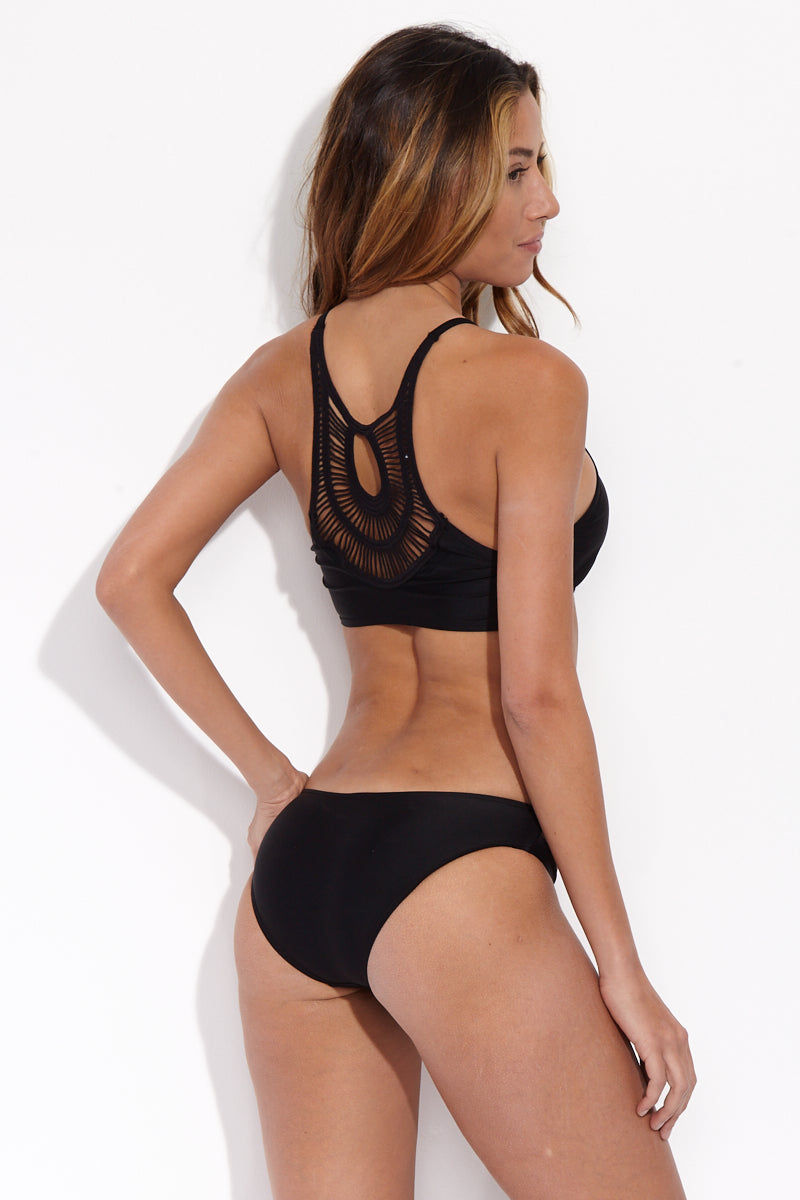 BEACH JOY Sexy Cut Out Bikini Bottom - Licorice Bikini Bottom | Licorice| Beach Joy Sexy Cut Out Bikini Bottom - Licorice. Back View. Sexy cut-out bikini bottom in classic black. Sides have double-strap look with front cut-outs. Stretchy material offers moderate rear coverage.