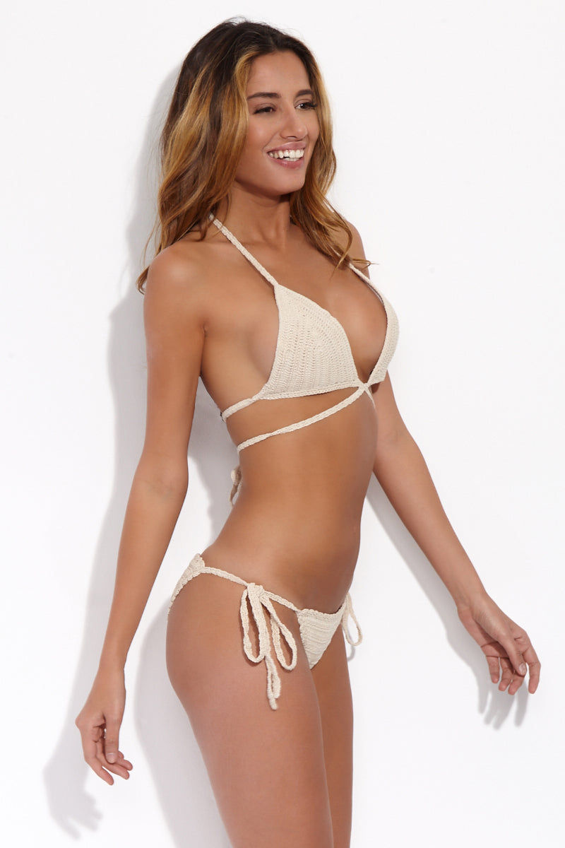 BEACH JOY Crochet Wrap Bikini Top - Nude Bikini Top | Nude| Beach Joy Crochet Wrap Bikini Top - Nude. Side View. Double crochet stitch triangle bikini top in buttermilk tan color. Crochet string at sides that can be tied at mid-back. Convertible string at front center can be wrapped around below chest and tied in back, pulled around the neck, or worn in a sexy wrap-around  look.