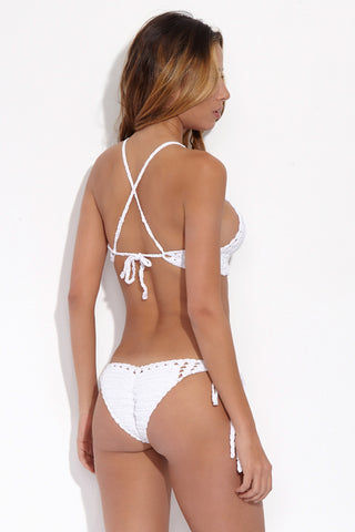 BEACH JOY Crochet Cut Out Bralette Bikini Top - Daisy White Bikini Top | Daisy White| Beach Joy Crochet Cut Out Bralette Bikini Top - Meringue. Back View. Double stitched bralette top. V-neckline with feminine cut outs. Crochet Strings extended from top front over the shoulders, cross in back, loop into the side back panels, and tie in the mid-back.