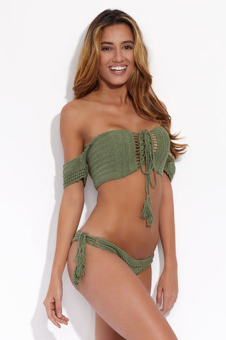 BEACH JOY Crochet Tie Side Bikini Bottom - Matcha Latte Bikini Bottom | Matcha Latte| Beach Joy Crochet Tie Side Bikini Bottom - Matcha Latte. Side View. Double Crochet stitched bikini bottom. Body ruched with cheeky coverage and flattering tie side strings. Cutouts at rear and front sides adding a sexy see through look.