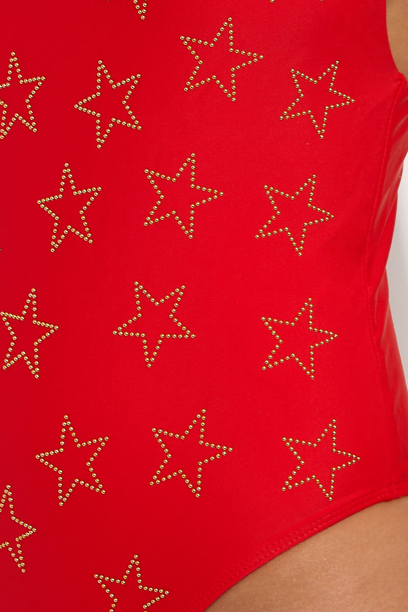 BEACH RIOT Bridget Beaded Deep V One Piece Swimsuit - Audrey Red Star Print One Piece | Audrey Red Star Print| Beach Riot Bridget Beaded Deep V One Piece Swimsuit - Audrey Red Star Print one piece with v-neckline. Allover gold studded star detailing. High cut leg. Adjustable spaghetti straps. Cheeky coverage. Front View