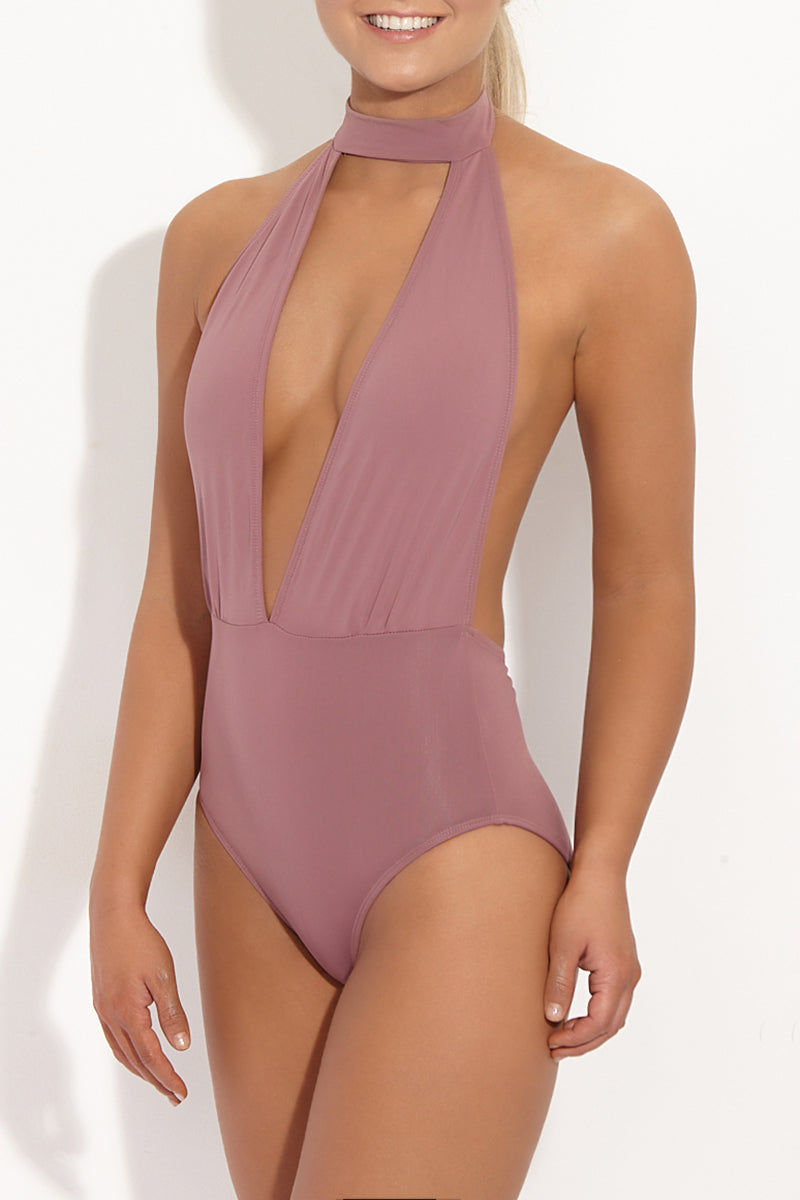 BETH RICHARDS Stella Plunging V One Piece Swimsuit - Petal Pink One Piece | Petal Pink| Beth Richards Stella Plunging V One Piece Swimsuit - Petal Pink. Front View. Plunging V neckline. Choker closure. Open back. Moderate coverage.