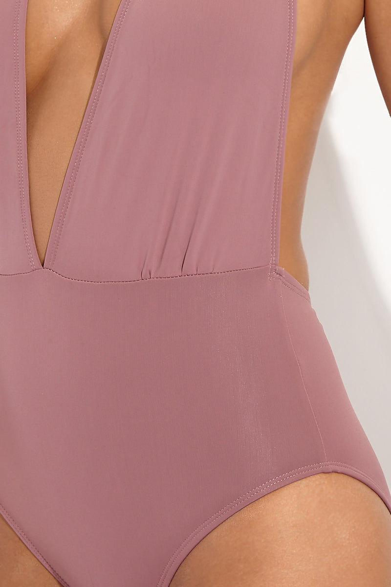 BETH RICHARDS Stella Plunging V One Piece Swimsuit - Petal Pink One Piece | Petal Pink| Beth Richards Stella Plunging V One Piece Swimsuit - Petal Pink. Detailed View. Plunging V neckline. Choker closure. Open back. Moderate coverage.